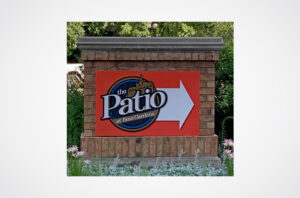 Patio at Bess Gardens Sign